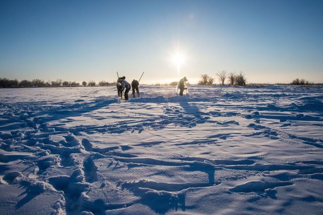 villagers harvest ice from a local lake near the settlement of oy, some 70 km south of yakutsk, with the air temperature at about minus 41 degrees celsius, on november 27, 2018   many people in the sakha yakutia republic depend on melted water as there is no other way to supply water due to extremely cold winter temperatures in the permafrost covered region photo by mladen antonov  afp        photo credit should read mladen antonovafp via getty images