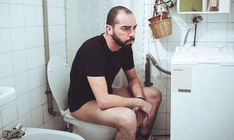 Sick man in the toilet