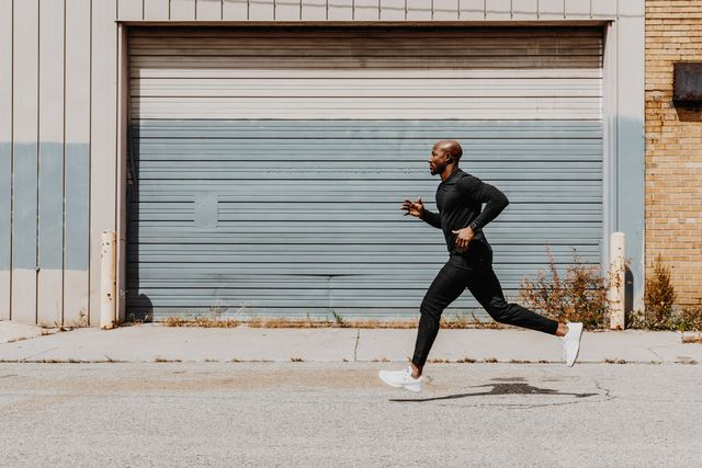 side view of man jogging in city