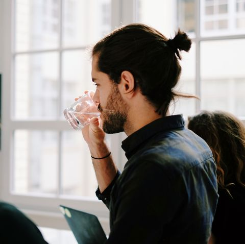 Side View Of Three People In Office Meeting