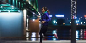 Side View Of Woman Running By River At Night