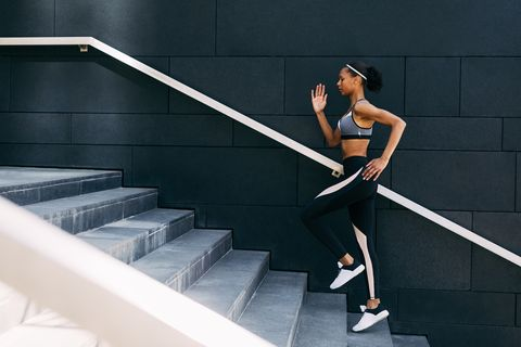Side View Of Woman Running On Staircase