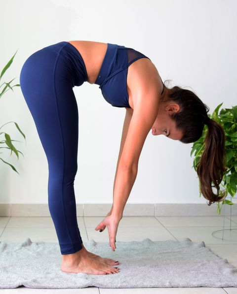 Side View Of Young Woman Doing Yoga On Floor