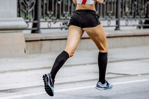 side view of young woman legs in compression socks