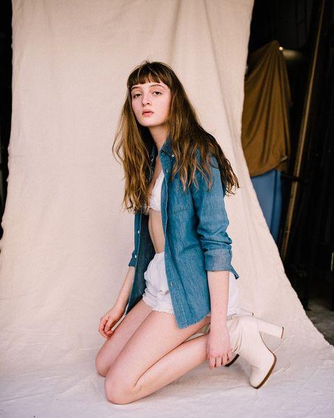Blue, Clothing, Green, Beauty, Skin, Leg, Fashion, Human leg, Long hair, Sitting,