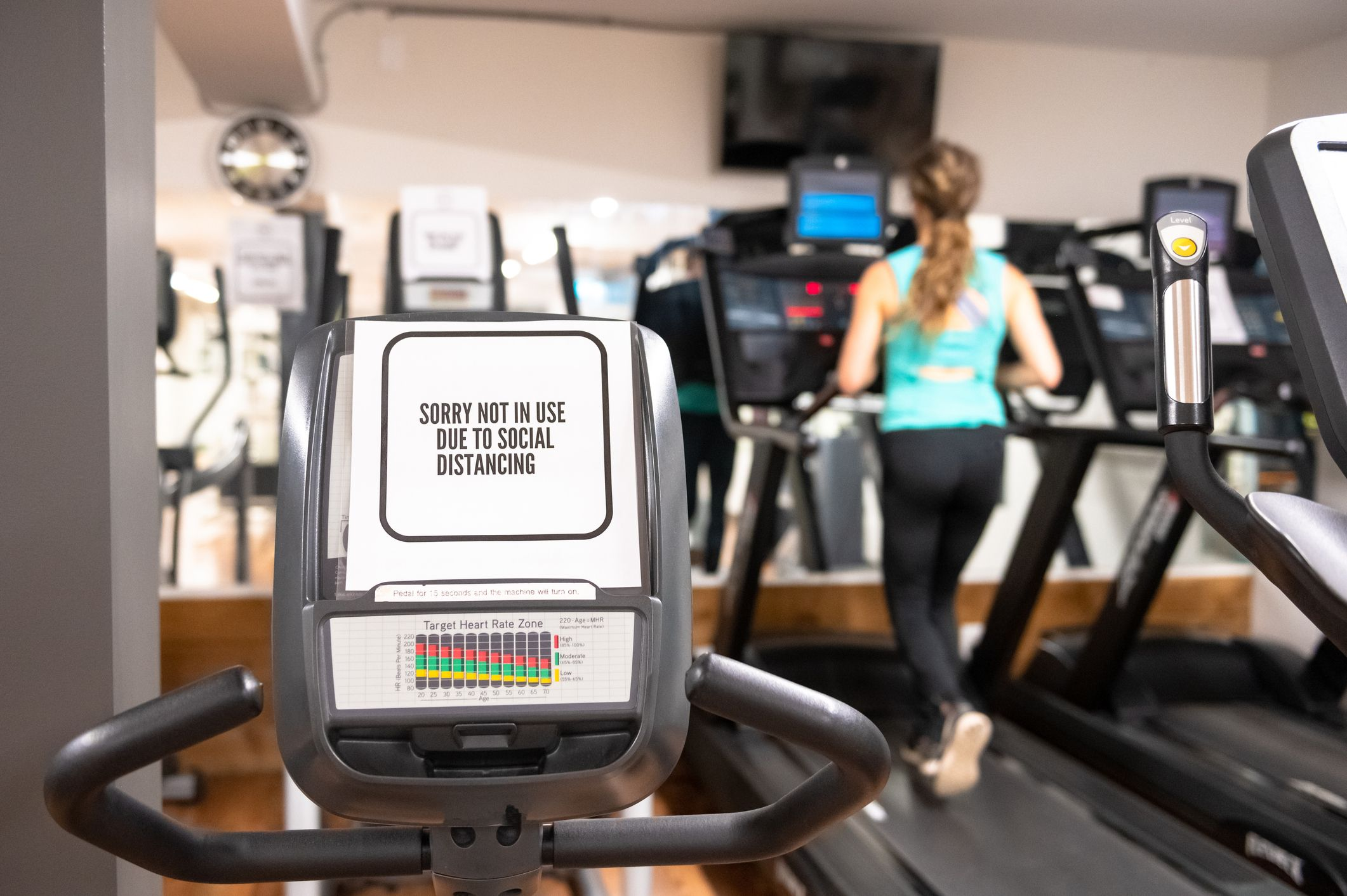 Gyms Might Re-Open Soon. If They Do, Here's How to Stay As Safe as Possible