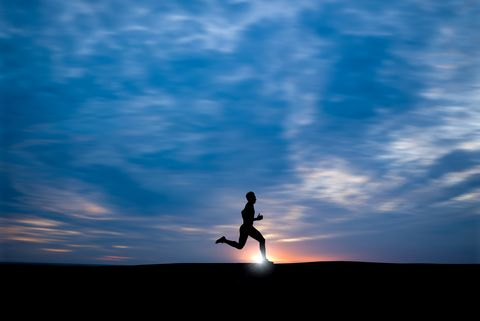 Silhouette Man Running Against Cloudy Sky During Sunset