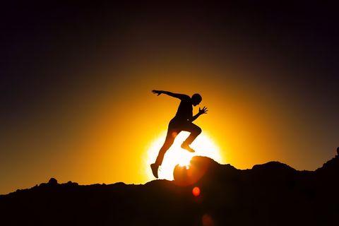 Silhouette Man Running Against Sky During Sunset