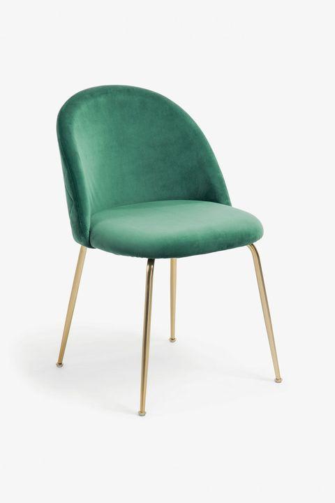 silla de terciopelo verde con patas doradas