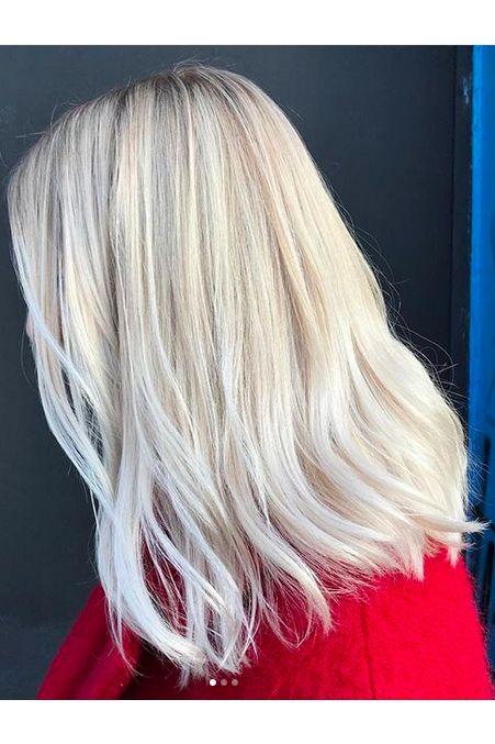 Hair, Blond, Hairstyle, Hair coloring, Layered hair, Wig, Chin, Long hair, Human, Fashion accessory,