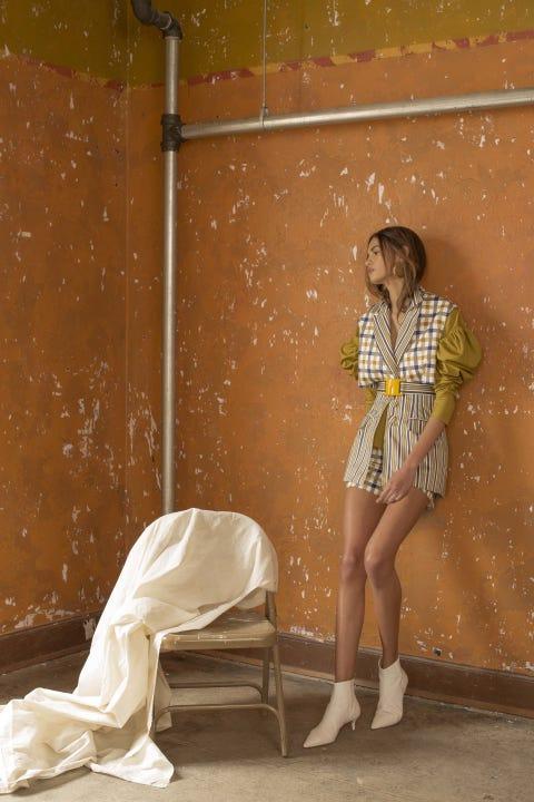 Yellow, Wall, Leg, Fashion, Sitting, Human leg, Shoe, Art,