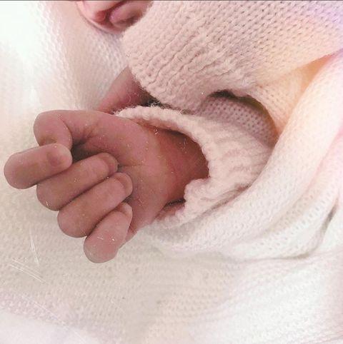 Skin, Baby, Child, Hand, Nose, Finger, Close-up, Pink, Nail, Leg,