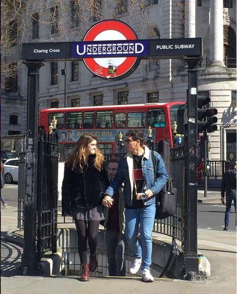 Pedestrian, Street, Urban area, City, Building, Photography, Jacket, Tourism, Jeans, Signage,