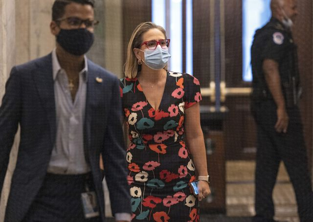 washington, dc   september 22 sen kyrsten sinema d az walks to the senate chambers at the us capitol on september 22, 2021 in washington, dc the senate is currently working towards an agreement to fund the government and increase the debt limit  photo by kevin dietschgetty images