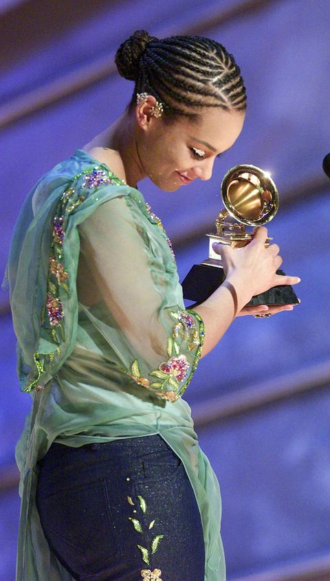 Singer Alicia Keys accepts her Grammy for Best R&B