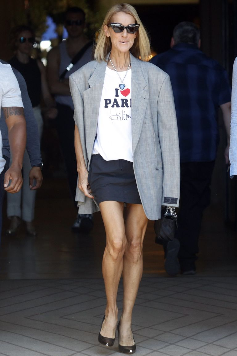 "For this cheeky look, Dion paired an ""I Love Paris Hilton"" tee with a miniskirt, oversized blazer, and simple pumps. And if you look closely, you'll see that she's wearing the Heart of the Ocean necklace from Titanic."