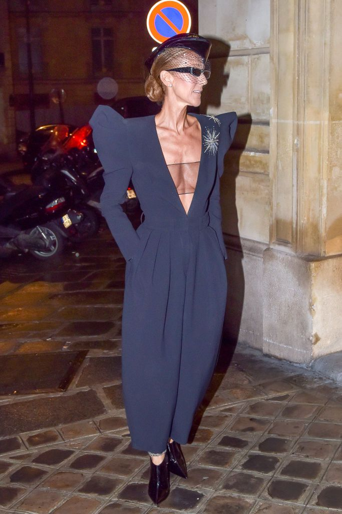 f88c2171954 Celine Dion Is a High Fashion Flight Attendant in This Plunging Black  Alexandre Vauthier Jumpsuit