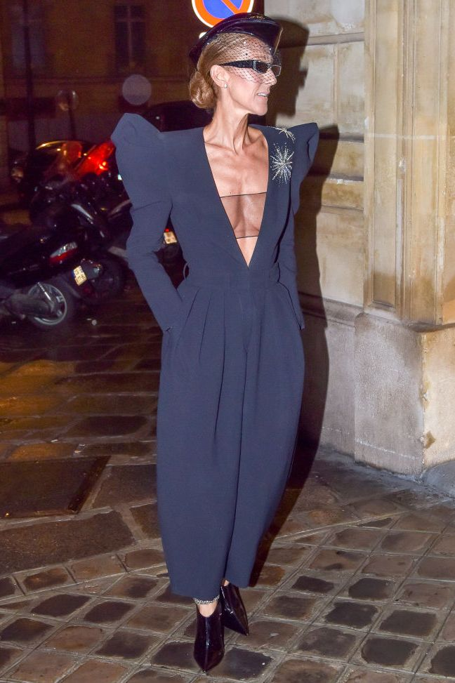 For a night out in Paris, Dion chose a plunging navy jupmsuit with gorgeous exaggerated shoulder detailing. She added a matching hat, sleek black booties, and sunglasses, of course.