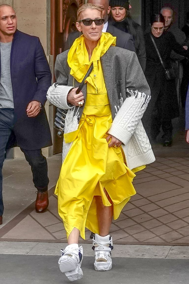Perhaps a nod to Billie Eilish's signature oversized wardrobe, Dion stepped out in Paris wearing a boxy grey blazer, bright yellow dress, and chunky sneakers.