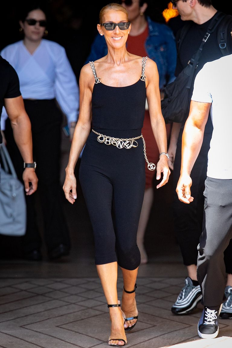 Celine certainly does athleisure better than we do. For this monochrome look, she paired a catsuit with Chanel bling, a Chanel chain belt, and black ankle-strap heels.