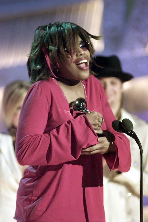 Singer Macy Gray receives her trophy for the Best