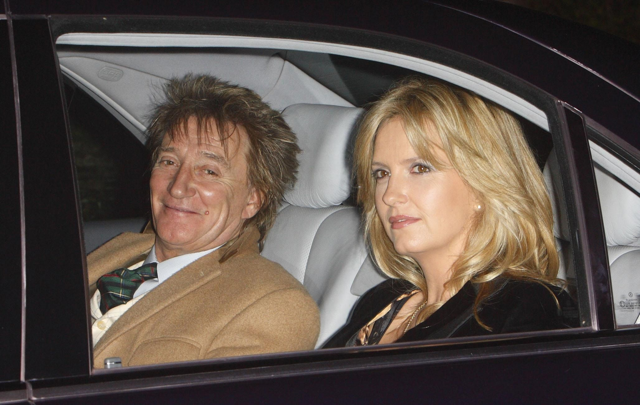 Rod Stewart and his wife Penny Lancaster arrive at Prince Charles's 60th birthday party at his country home.
