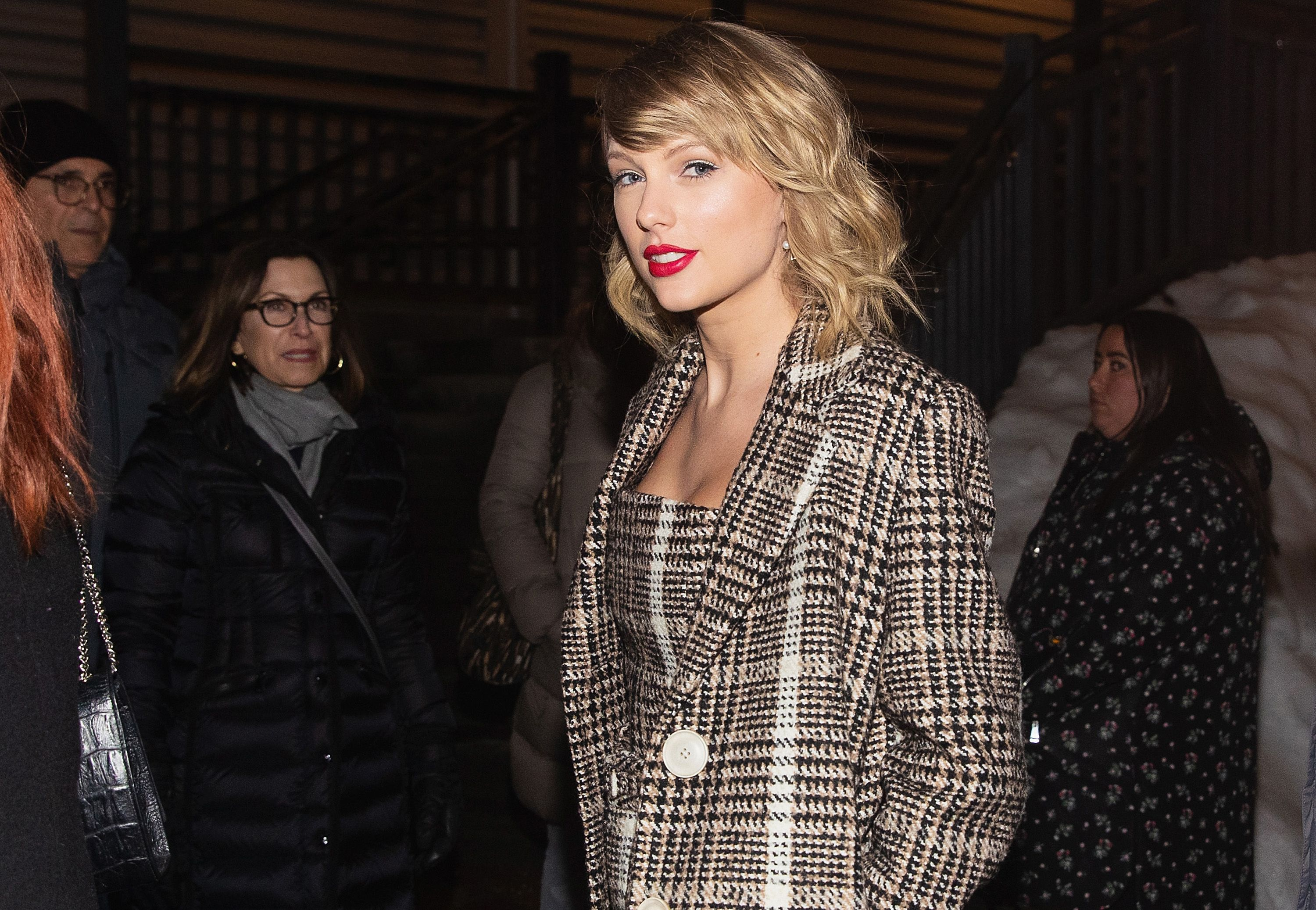 Taylor Swift Looked Incredible in a Plaid Jumpsuit and Trench at Her 'Miss Americana' Premiere