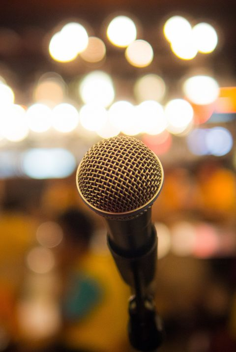Single microphone with blurred background.