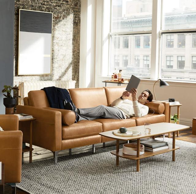 a man on a sofa reading