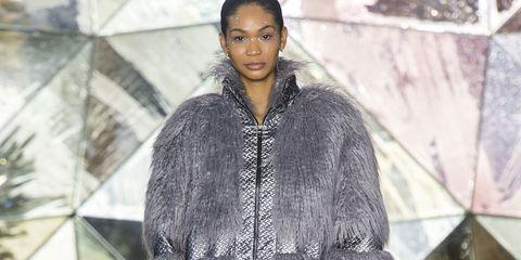 Fashion show, Fashion model, Fashion, Clothing, Runway, Fur, Outerwear, Footwear, Public event, Human,