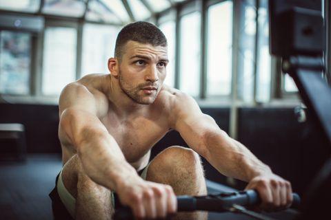 Man training on rowing machine