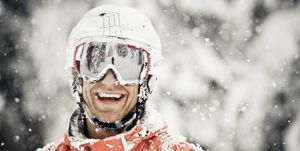 Skier Man Smiles as The Snow Falls