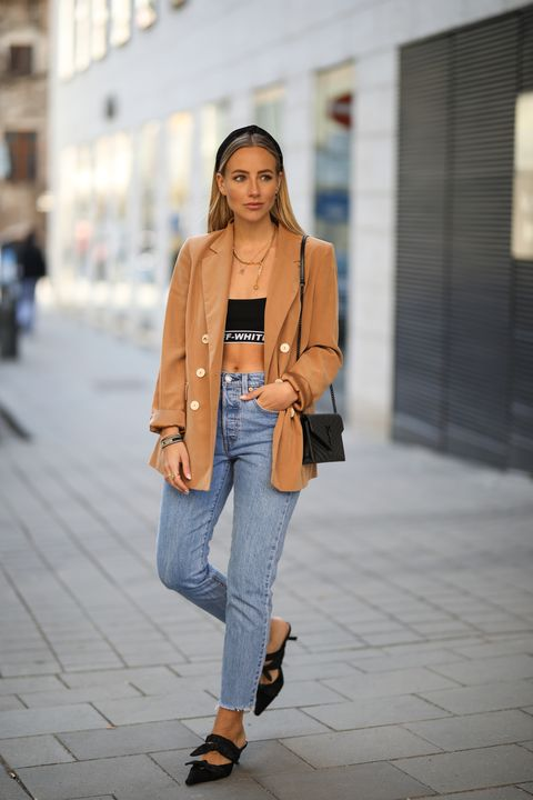 munich, germany   march 24 christina bischof christinabiluca wearing mango blazer, levis 501 skinny jeans, zara heels, ysl bag, top offwhite, kapten  son glasses and black palms chain on march 24, 2019 in munich, germany photo by jeremy moellergetty images