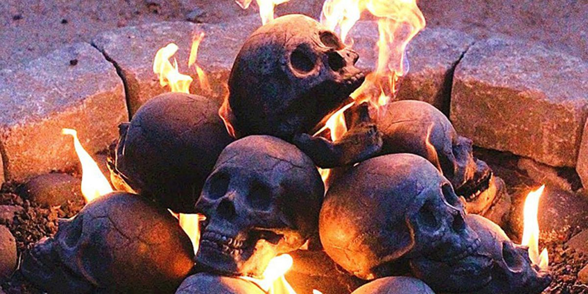 These Skull Logs Will Turn Your Fire Pit Into a Spooky Centerpiece This Halloween