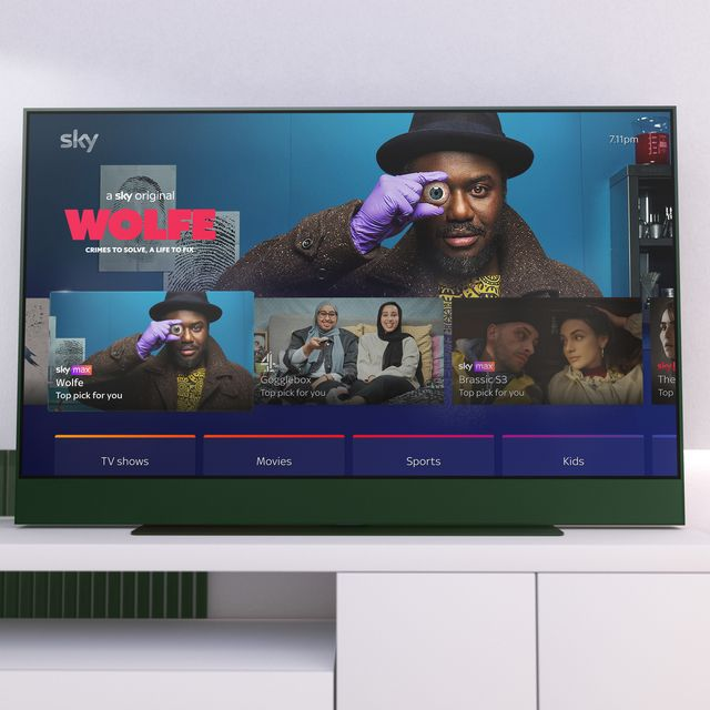 sky glass tv in racing green with wolfe shown on the display