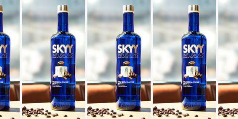 Liqueur, Drink, Distilled beverage, Alcoholic beverage, Bottle, Product, Alcohol, Vodka, Glass bottle, Skyy vodka,