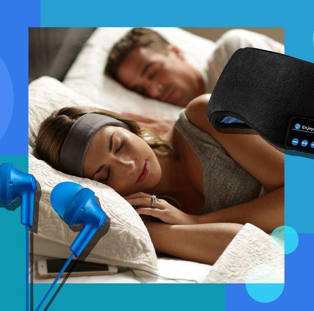 woman using sleep headphones in bed