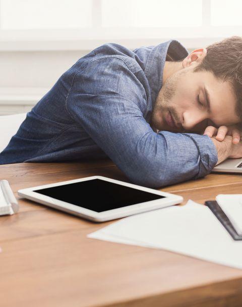 Sleeping businessman in modern office