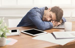 Sleeping businessman in modern office