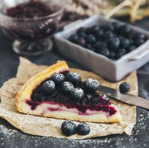 slice of blueberry pie with blueberries and jam
