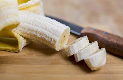 sliced banana on wood