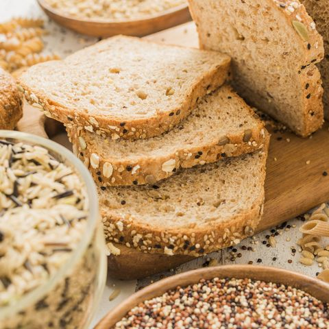 Healthy Carbs: Sliced brown bread on cutting board
