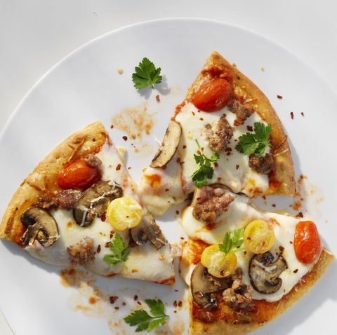 Slices of Pizza on a White Plate, White Table