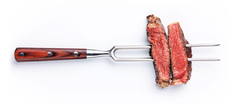 Slices of steak on meat fork