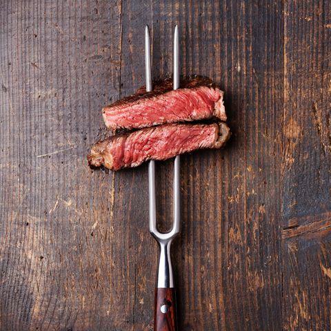 Slices of Steak Ribeye on meat fork