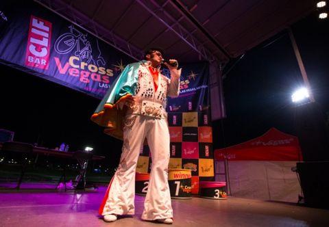 Entertainment, Stage, Performance, Music venue, Artist, Costume, Stage equipment, Elvis impersonator, Performance art, Kimono,