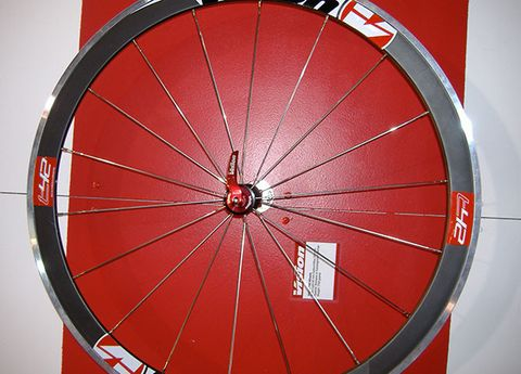 Bicycle wheel rim, Rim, Spoke, Red, Carmine, Synthetic rubber, Maroon, Circle, Bicycle tire, Parallel,