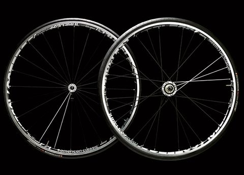 Bicycle wheel rim, Spoke, Bicycle tire, Rim, Bicycle wheel, Black, Synthetic rubber, Carbon, Circle, Bicycle part,