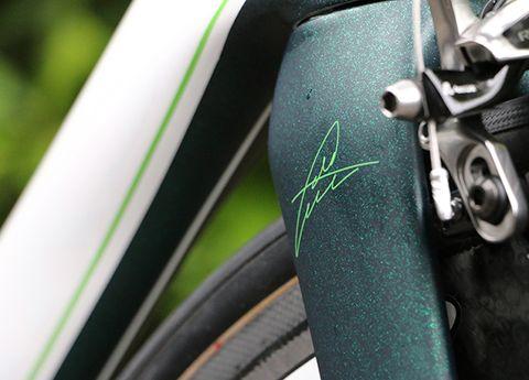 Bicycle tire, Bicycle wheel rim, Green, Bicycle accessory, Bicycle part, Rim, Fender, Bicycle wheel, Spoke, Bicycle,