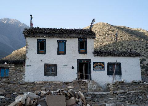 Window, House, Door, Rock, Mountain range, Roof, Cottage, Village, Rubble, Hill station,